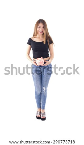 Young woman holding a piggy bank against a white background - stock photo