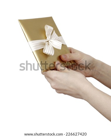 Young woman holding a present in hands - stock photo