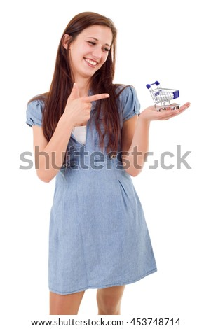 Young woman holding a small shopping cart, isolated - stock photo