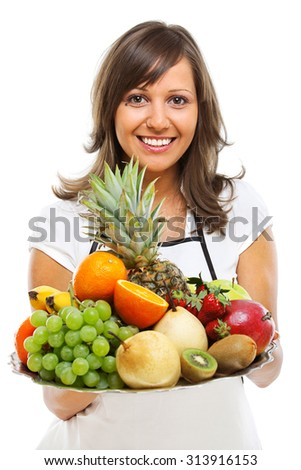 Young woman holding a tray with fresh fruits - apples, pears, grapes, pineapple, oranges, kiwi, strawberries and others. Isolated on white background. Vertical shot.