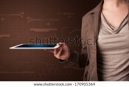 Young woman holding a white tablet with blurry apps