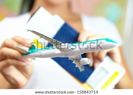 Young Woman Holding Airplane - stock photo