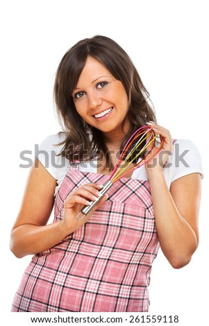 Young woman holding an egg beater, isolated on white background