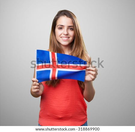 young woman holding an iceland flag on white