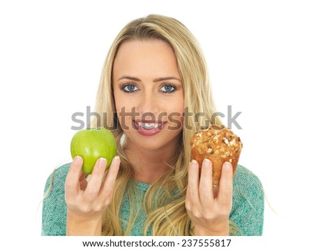 Young Woman Holding and Comparing Cake and Fruit