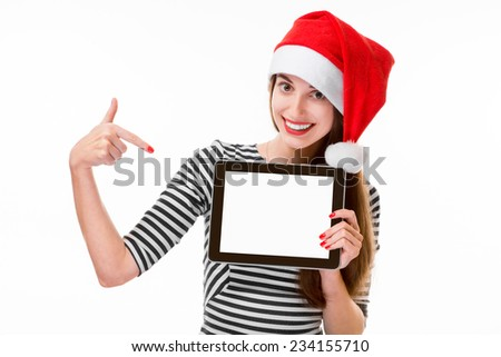 Young woman holding and showing digital tablet with empty screen on Christmas isolated on white background - stock photo