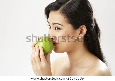 young woman holding apple - stock photo