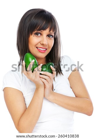 Young woman holding avocado isolated on white background