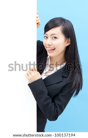 young woman holding blank billboard, isolated on blue background - stock photo