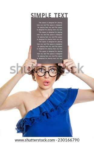 Young woman holding blank pannel or board over her head, isolated on white. Copyspace - stock photo