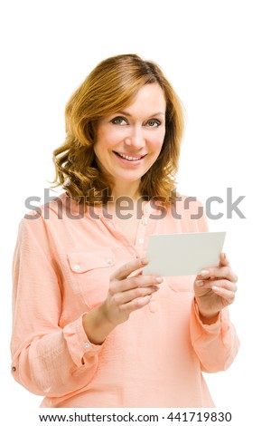 Young woman holding blank signboard. - stock photo