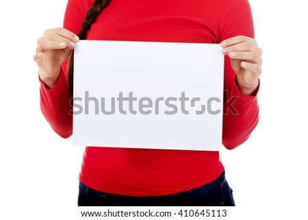 Young woman holding blank white banner