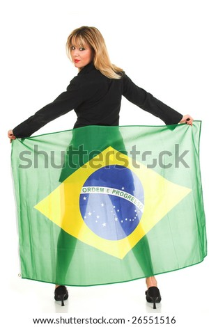 Young woman holding Brazil flag on her back - stock photo