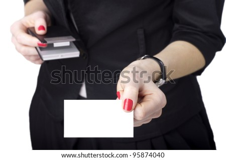 Young woman holding business card isolated on white - stock photo