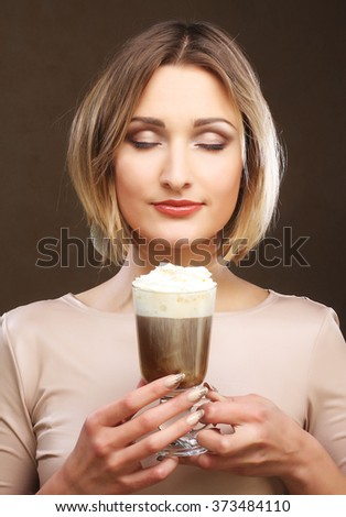 young woman holding cafe latte cup  - stock photo