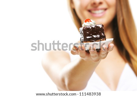 Young woman holding cake - stock photo