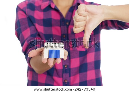 Young woman holding cigarettes and showing thumb down over white backgroud - stock photo