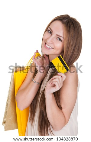 Young Woman Holding Credit Card Over White Background