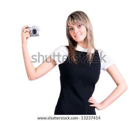 Young woman holding digital camera. Isolated on white.