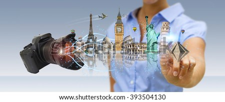Young woman holding digital camera taking shoots of famous monuments of the world - stock photo