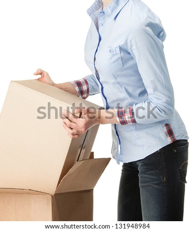 Young woman holding empty cardboard boxes; isolated on white - stock photo