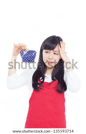 young woman holding empty wallet isolated on white background