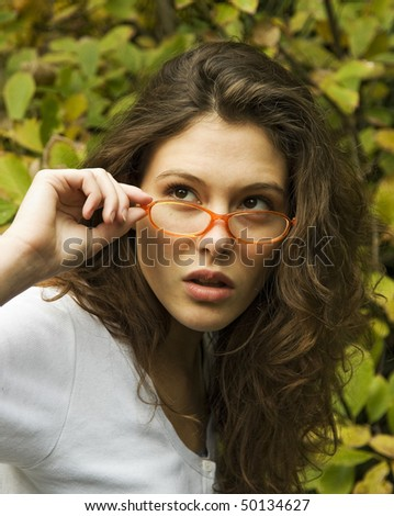 Young woman holding  glasses