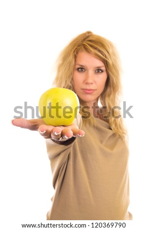 Young woman holding green apple - stock photo