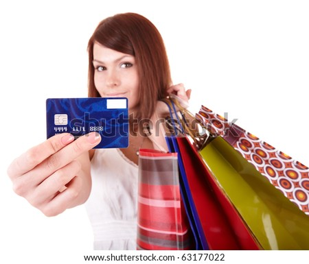 Young woman holding group shopping bag. Isolated.Sharpness is on a credit card - stock photo