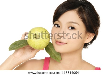 young woman holding guava fruit close up, - stock photo