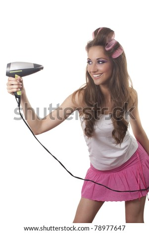 Young woman holding hair dryer