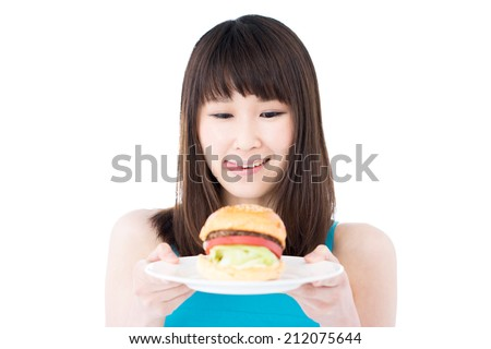 young woman holding hamburger, isolated on white background