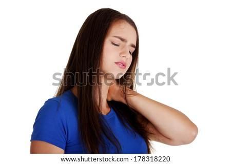 Young woman holding hand on her neck. Neck pain concept - stock photo