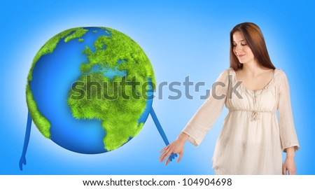 Young woman holding hands with Earth