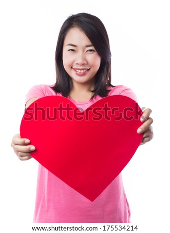 Young woman holding heart on white background