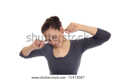 young woman holding her ears to - stock photo