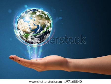 Young woman holding in her hand a glowing earth globe, Elements of this image furnished by NASA - stock photo