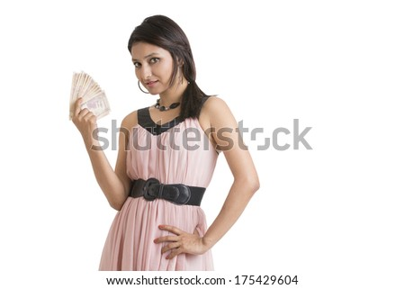 Young woman holding Indian currency notes - stock photo