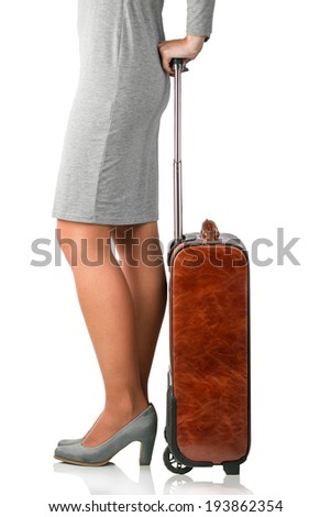 Young woman holding leather suitcase. Business trip concept - stock photo