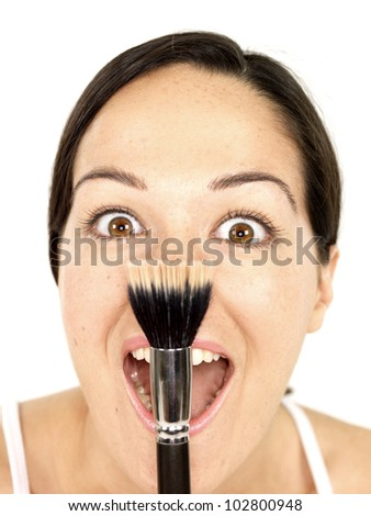 Young Woman Holding Makeup Brush