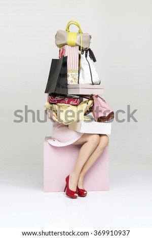 Young woman holding many shopping bags