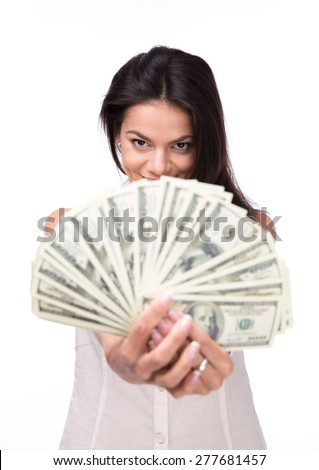 Young woman holding money over white background and looking at camera