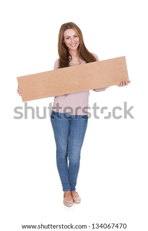 Young Woman Holding Placard Over White Background - stock photo