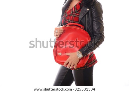 young woman holding red backpack  in black leather jacket white background