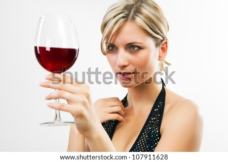 Young woman holding red wine - white background - stock photo