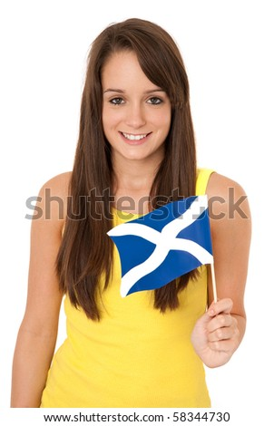 Young woman holding Scottish flag isolated on white
