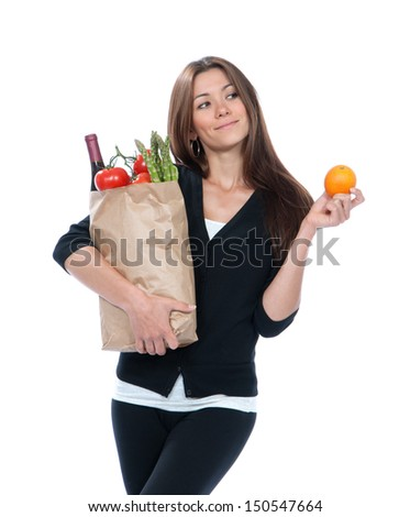 Young woman holding shopping bag with groceries vegetables and fruits isolated on white background. Healthy lifestyle eating concept - stock photo