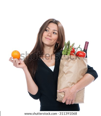 Young woman holding shopping bag with groceries vegetables and fruits isolated on white background. Healthy lifestyle eating concept