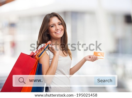 Young woman holding shopping bags - stock photo
