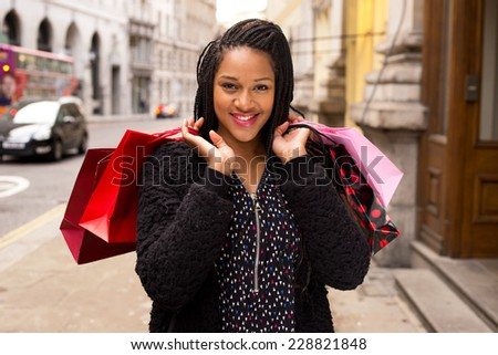 young woman holding shopping bags. - stock photo